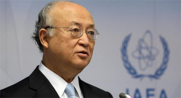Director General of the International Atomic Energy Agency, IAEA, Yukiya Amano of Japan addresses the media during a news conference after a meeting of the IAEA board of governors at the International Center in Vienna, Austria, Monday June 8, 2015. (AP Photo/Ronald Zak)
